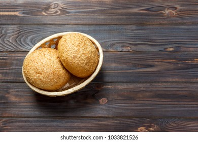 round buns with seeds. Bread in the basket. Freshly baked bread rolls with seed.