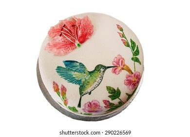 Round cake with fondant and painted hummingbird and flowers