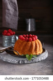 round cake with fresh raspberries for dessert