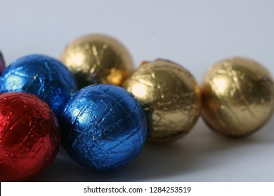 round candy in colorful foil