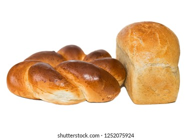 Round challah and a loaf of white bread are isolated on a white background. white bread loaf isolated. Loaf of bread isolated on white background