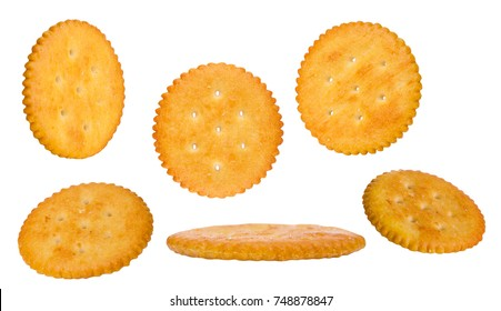 Round cheese crackers with salt isolated on white background. Diffrent sizes