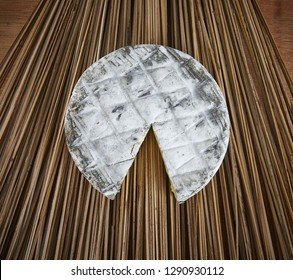 Round cheese on a wood backdrop