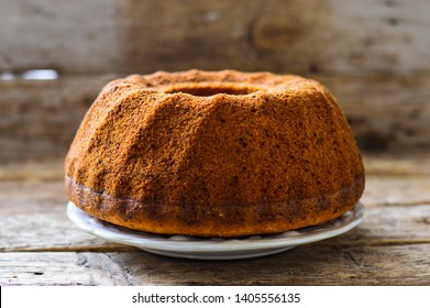 Round chocolate muffin (tart, pie) on wooden background