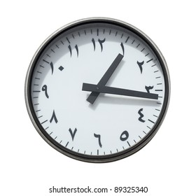 Round clock with classical arabic font (Naskh) isolated on a white