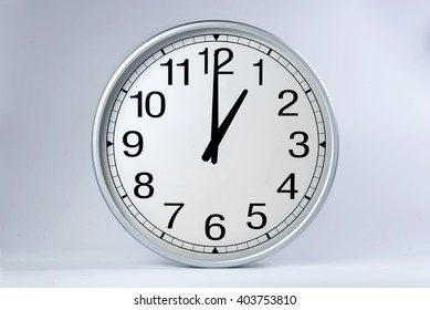Round clock shows shows at 1 o'clock,