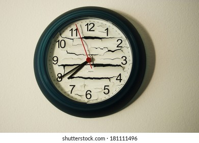 A round clock that has the background cracked, broken, and time is frozen. conecpt of broken time.