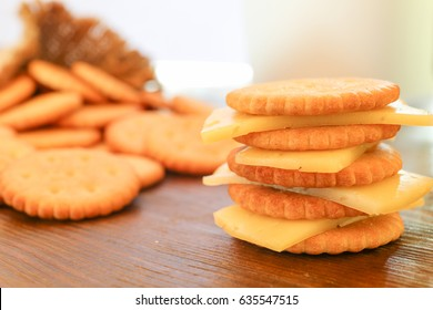 Round cookies cracker with cheese on a wooden table, closeup