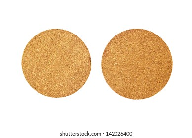 Round Cork coasters for glasses over white background, beer mats, top view