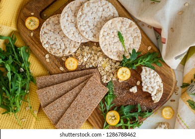 Round crispy rice crackers and Rye Crackers whith kumquat. Dietary concept and healthy vegetarian food