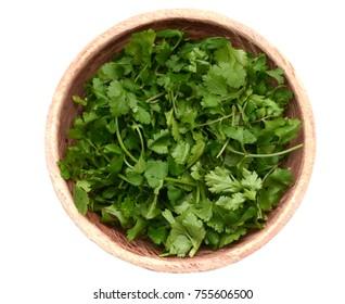 round cut cilantro herb on wooden bowl