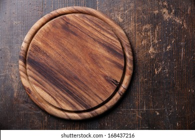 Round cutting board on Old wooden texture background