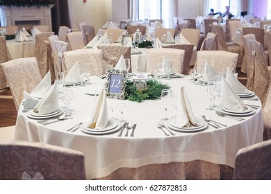 Round dinner table number 12 decorated with beige cloth