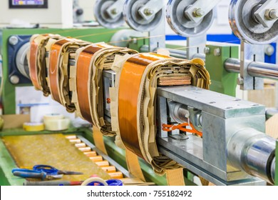 Round enamelled wires being wound to form HT (high tension) or HV (high voltage) rectangular coils for distribution transformers on winding machine
