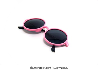 Round eyes pink sunglasses for kids isolated on white background with shadow