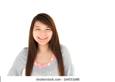 round face and white skin thai hairy woman with gray coat is smiling on white background (Blank area at right side)