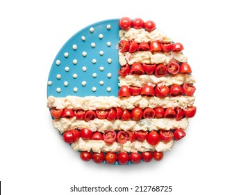 Round flag of the United States made of  tomato and salad on a plate isolated on white