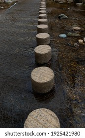 Round foot paths as stepping stone on creek.