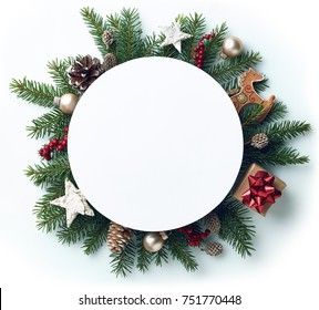 Round frame of Christmas tree branches and decorations with blank card and space for text. Top view. Xmas and New year concept