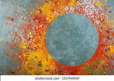 Round frame composition, different spices scattered on the table