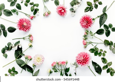 Round frame with pink flower buds, branches and leaves isolated on white background. lay flat, top view