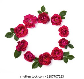 Round frame wreath made of pink roses and green leaves isolated on white background. Top view. Flat lay.