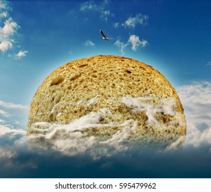 round fresh bread among the clouds in a bright blue sky