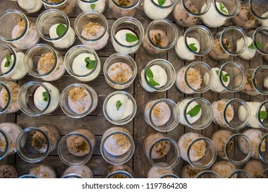 lot of round glass cups with healthy desserts