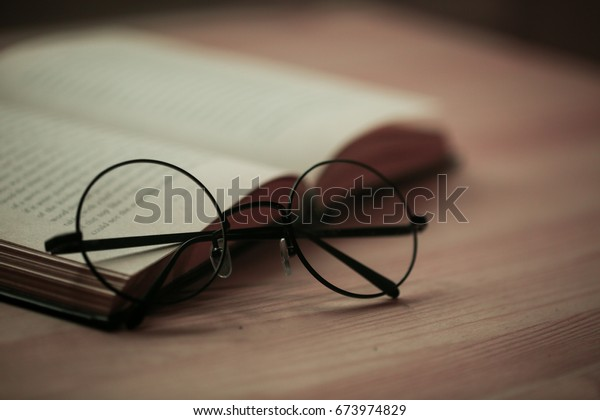 round glasses on a book