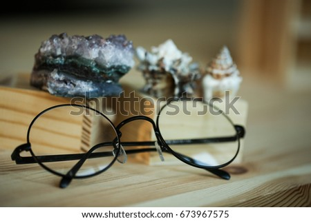 round glasses on a