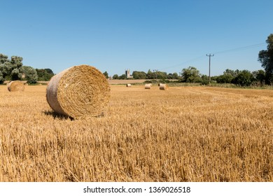 Round Hay Bales in a field near All Saints Church, Aldwincle, Northamptonshire