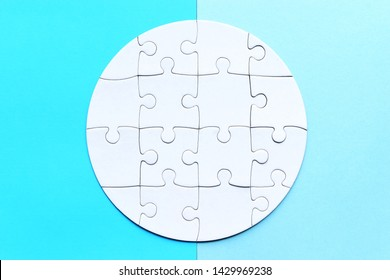 Round jigsaw puzzle on the blue background