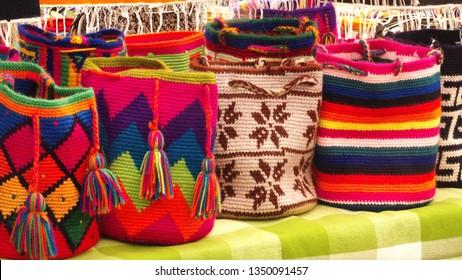 Round, knit bags at the Artisan's Market in Otavalo, Ecuador