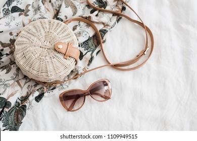 Round ladys wickered straw handbag on white linen