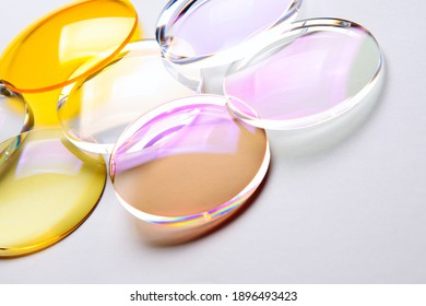 Round lenses for glasses with anti-reflective coating on a white background. Production of glasses and spectacle lenses. - Shutterstock ID 1896493423