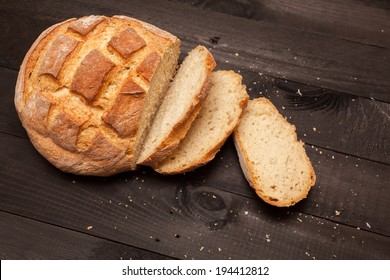 Round loaf bread with some slices cut