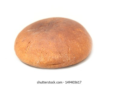 round loaf of brown bread on a white background
