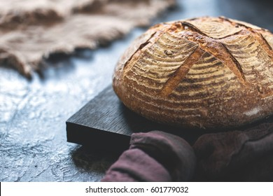 Round loaf of freshly backed sourdough bread, with copy space