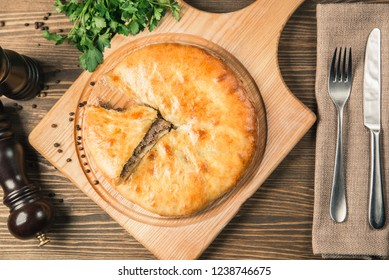Round meat pie. Traditional dish of the cuisine of the Caucasus