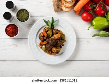 Round meatballs with vegetables in white plate ( Turkish; Misket Köftesi )