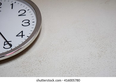 Round metal clock on white  wall