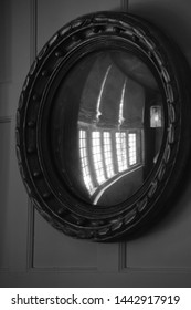 round mirror in old house
