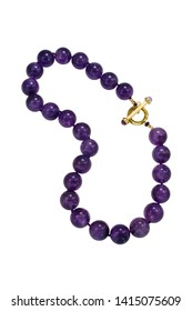 Round natural amethyst beads with a gold T clasp make up this necklace. Shown on a white background.