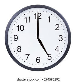 Round office clock showing five o'clock isolated on white background