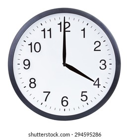 Round office clock showing four o'clock isolated on white background