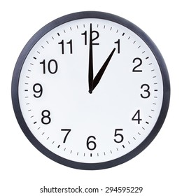 Round office clock showing one o'clock isolated on white background