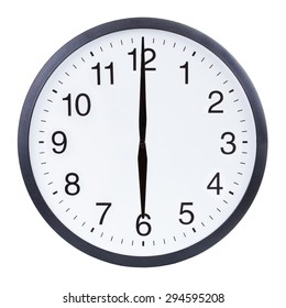 Round office clock showing six o'clock isolated on white background