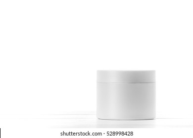 Round packaging of cream. Jar of cream isolated on white background