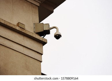 Round panoramic video security outdoor camera on old city building corner