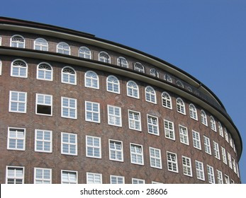 Round part of a brick building in Hamburg, Germany.